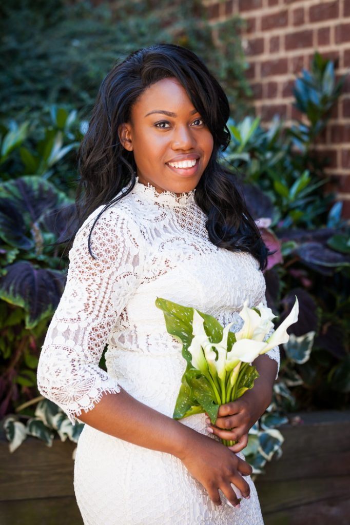 Bride holding bouquet of lilies before a Kew Gardens wedding