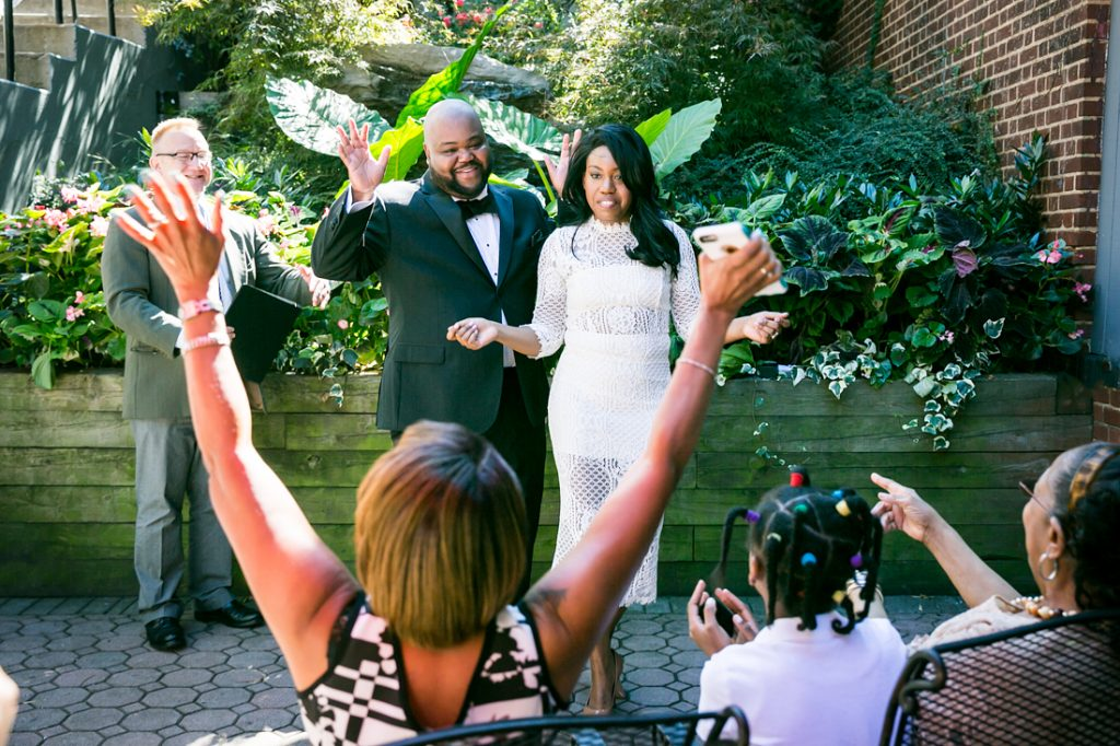 Guests cheering after wedding ceremony