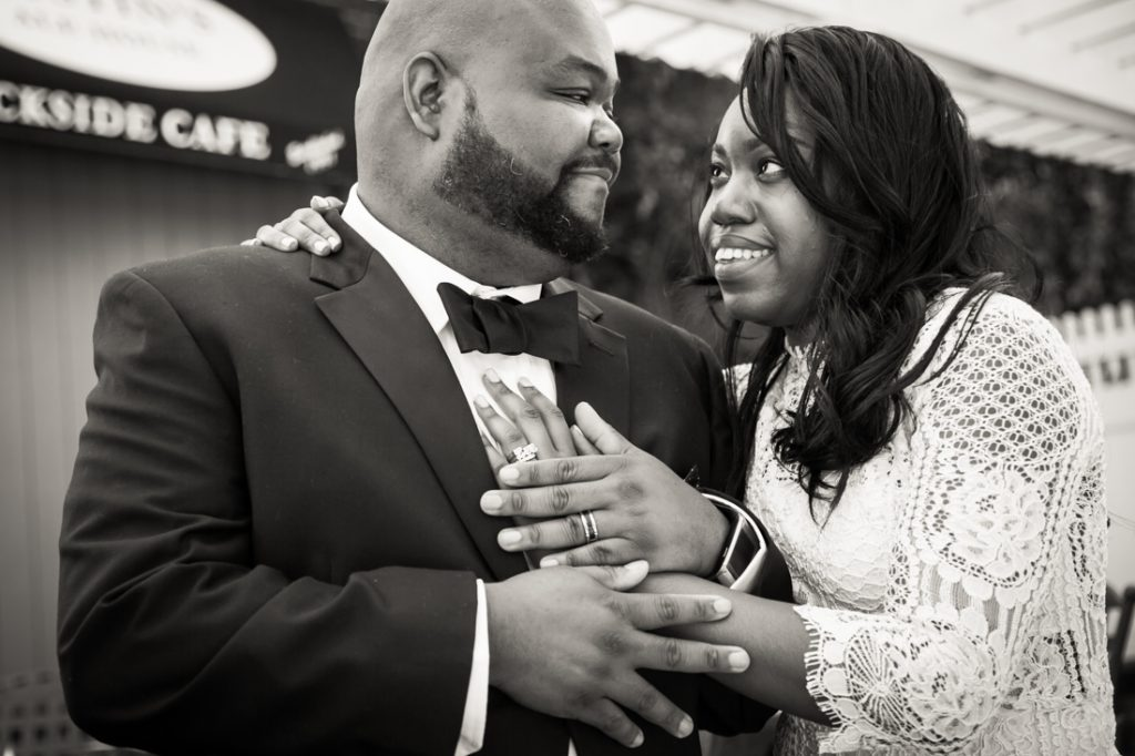 Black and white portrait of bride and groom looking at each other