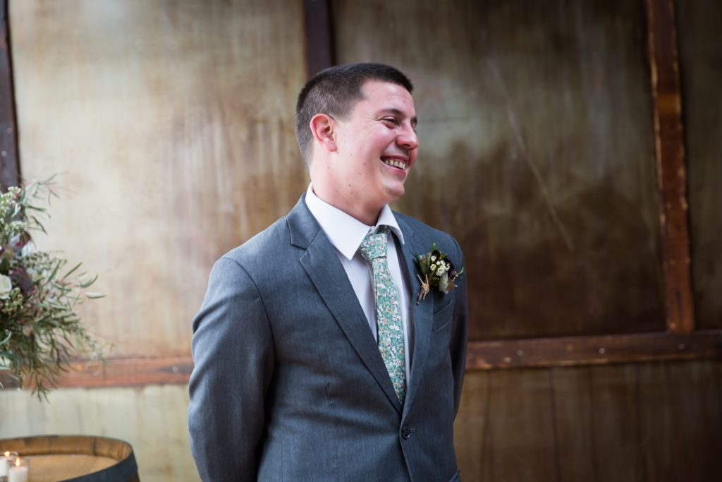 Groom smiling at bride during Brooklyn Winery ceremony
