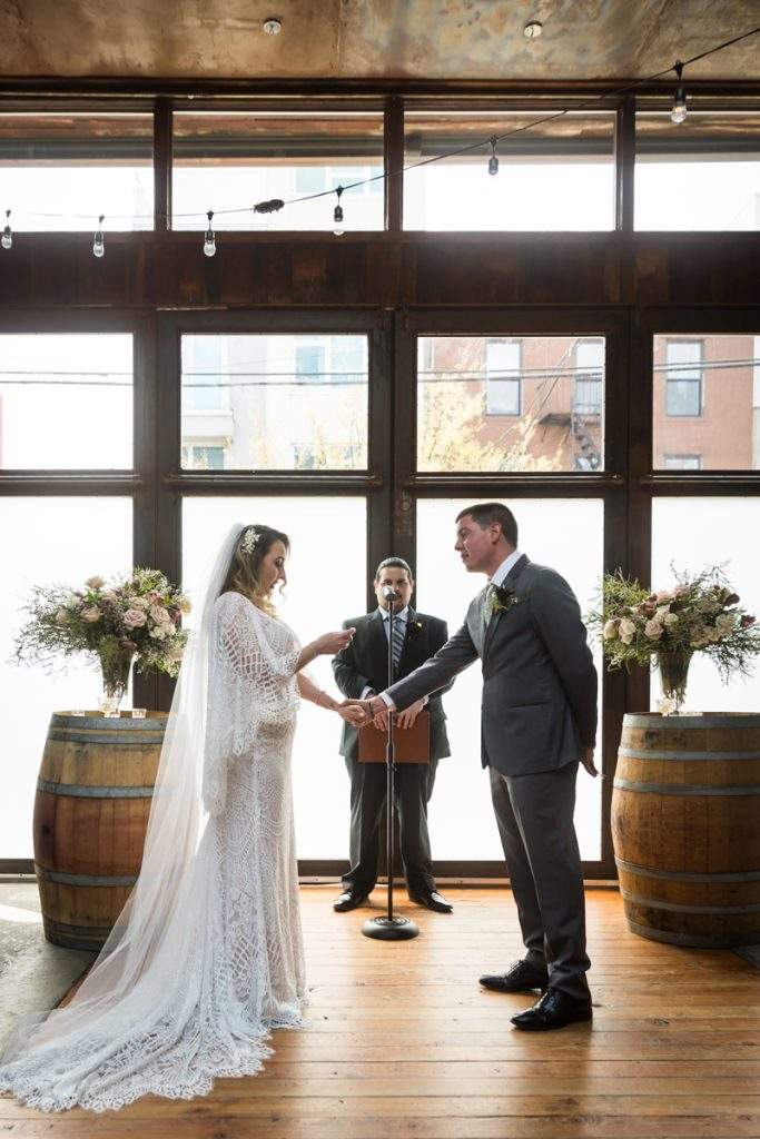 Brooklyn Winery wedding photos of bride and groom exchanging vows