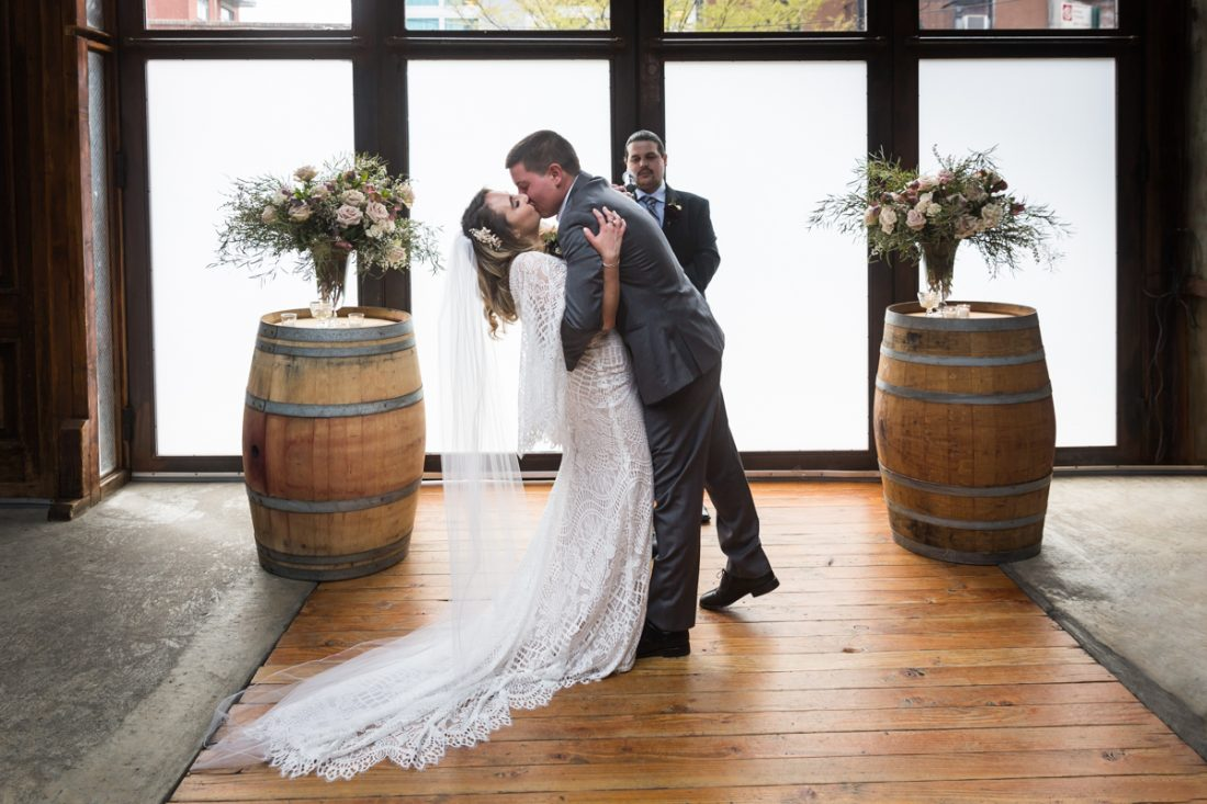 Brooklyn Winery wedding photos of bride and groom kissing after ceremony