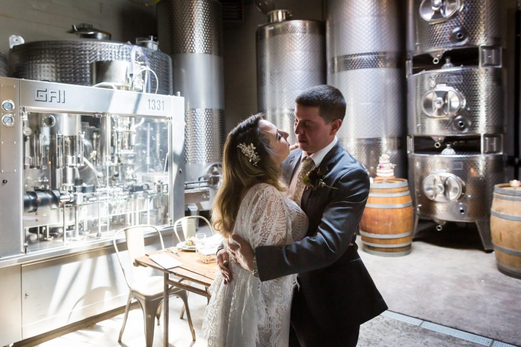 Brooklyn Winery wedding photos of bride and groom hugging
