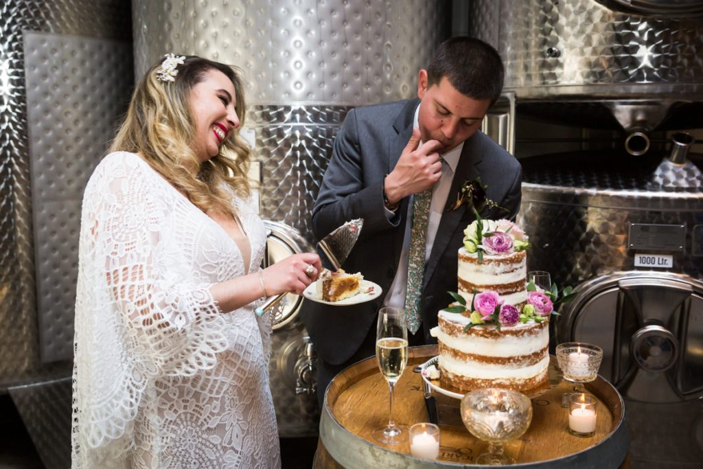 Bride and groom cutting cake during Brooklyn Winery wedding reception