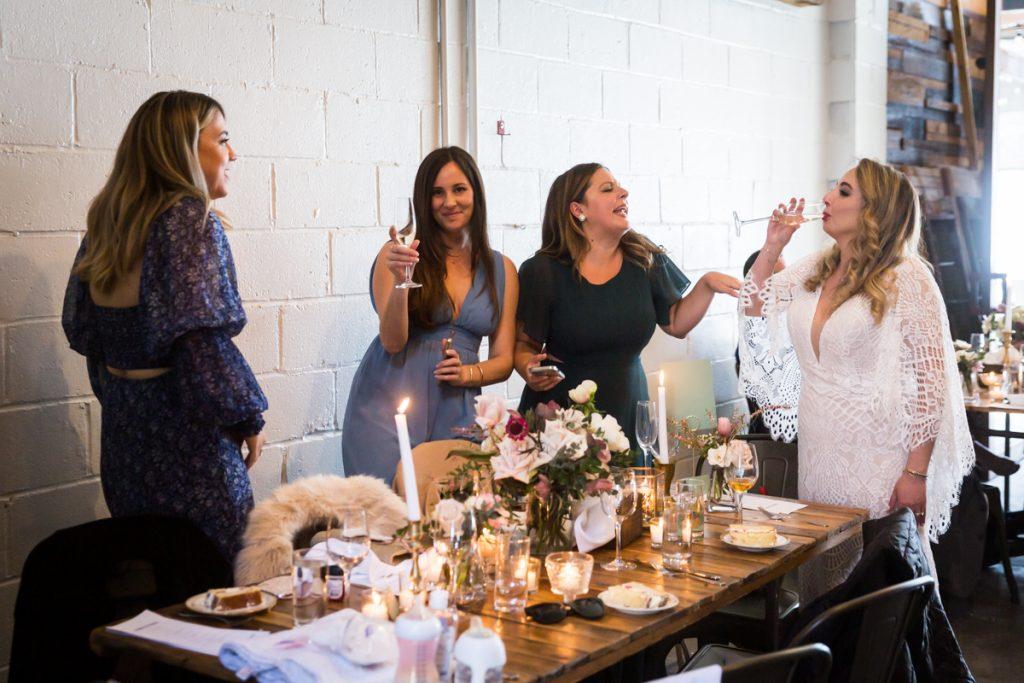 Bride and girlfriends enjoying Brooklyn Winery wedding reception