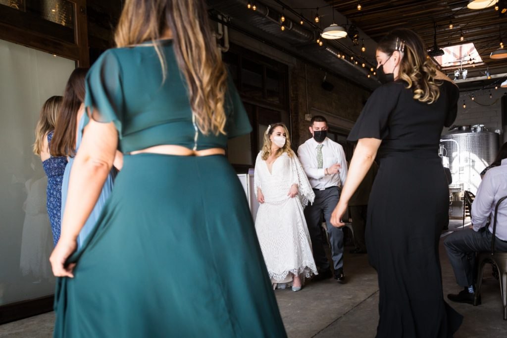Bride and groom dancing with guests at Brooklyn Winery wedding reception