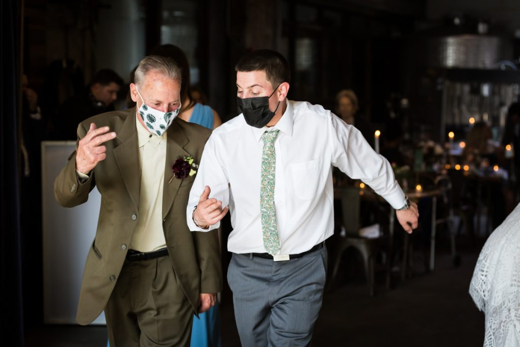 Groom and father dancing in tandem during Brooklyn Winery wedding reception