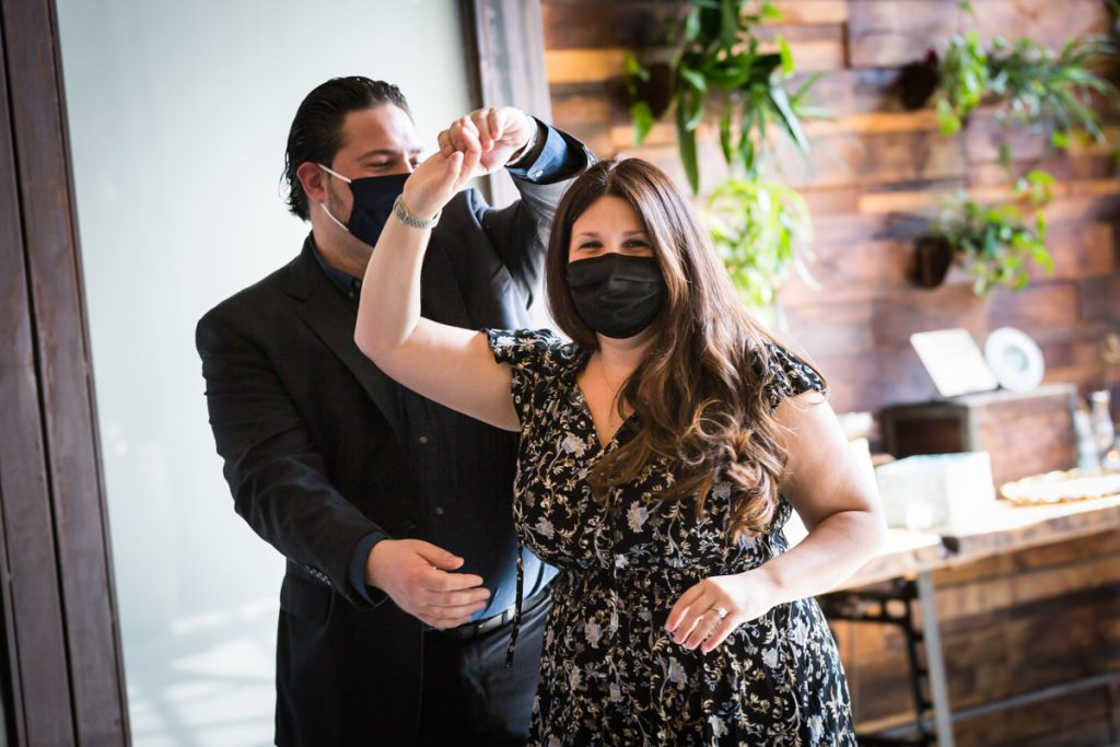 Couple wearing masks and dancing at Brooklyn Winery wedding reception
