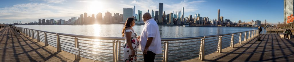 Panorama shot of couple along waterfront during a Long Island City maternity portrait session