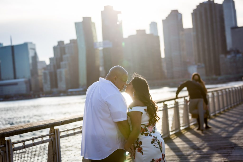 Couple kissing on pier at Gantry Plaza State Park