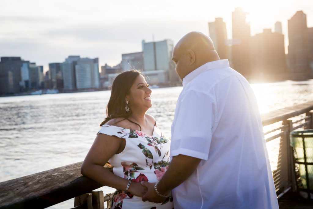 Couple leaning against pier railing at Gantry Plaza State Park