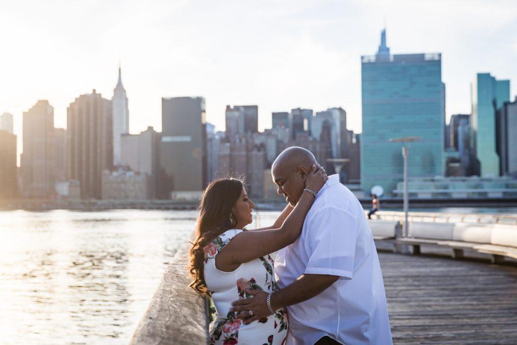 Couple hugging on pier of Gantry Plaza State Park