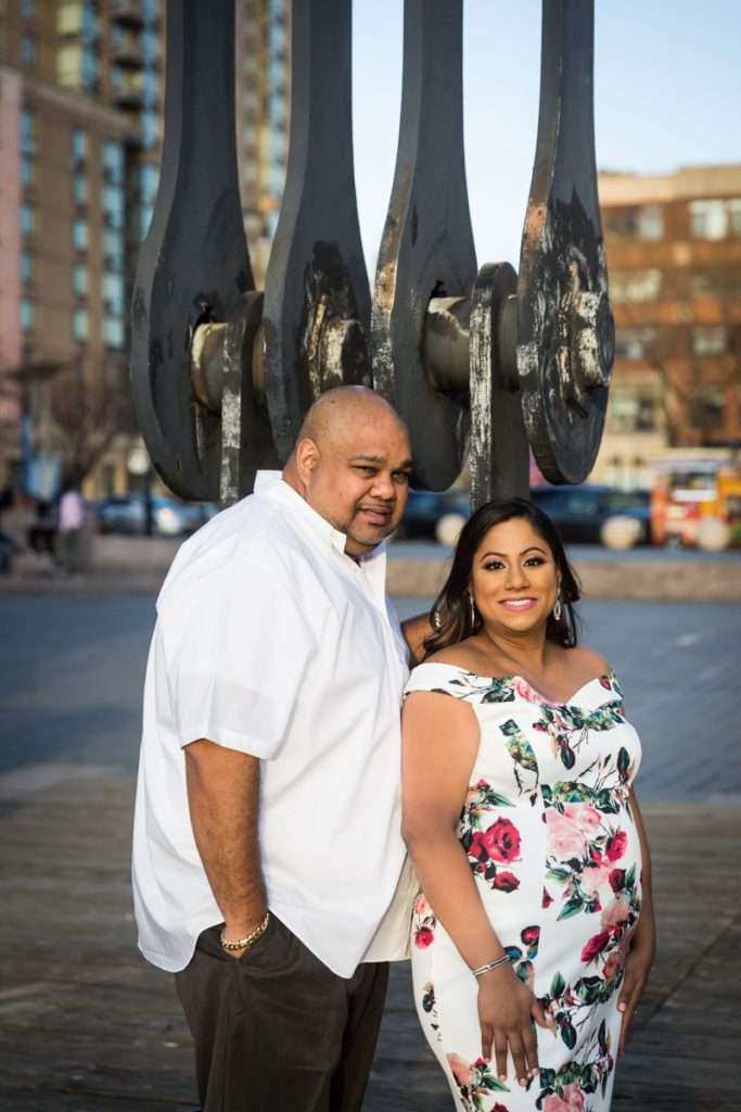 Couple standing in front of gantry at Gantry Plaza State Park