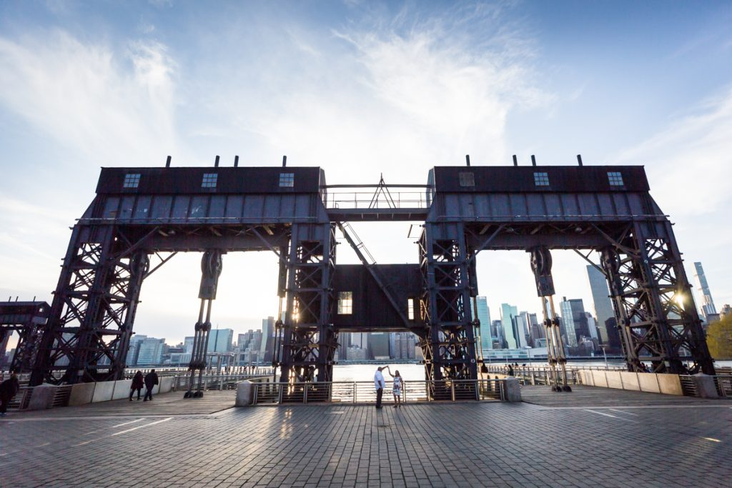 Couple dancing in front of gantries at Gantry Plaza State Park