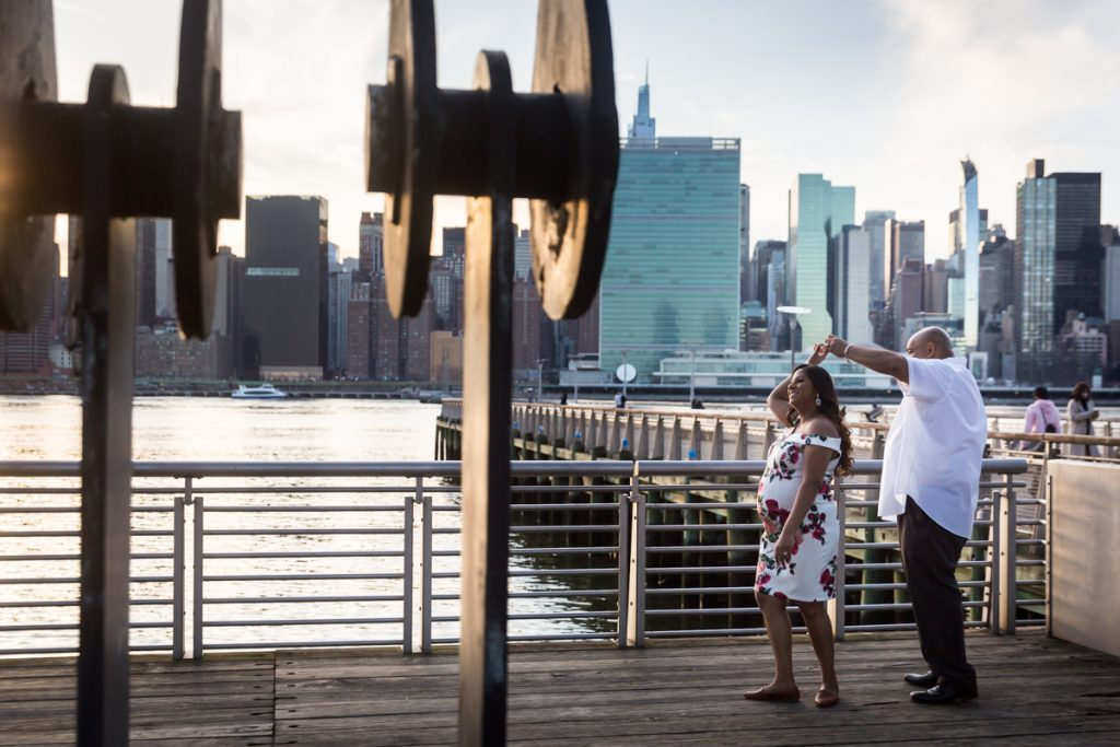 Couple dancing on pier at Gantry Plaza State Park