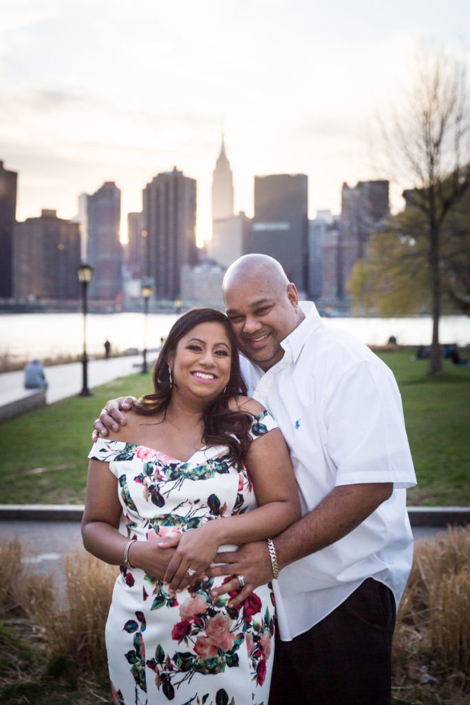 Expectant couple during Long Island City maternity portrait session at Gantry Plaza State Park