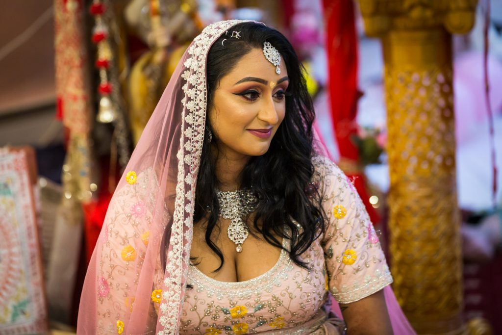 Hindu bride wearing pink sari