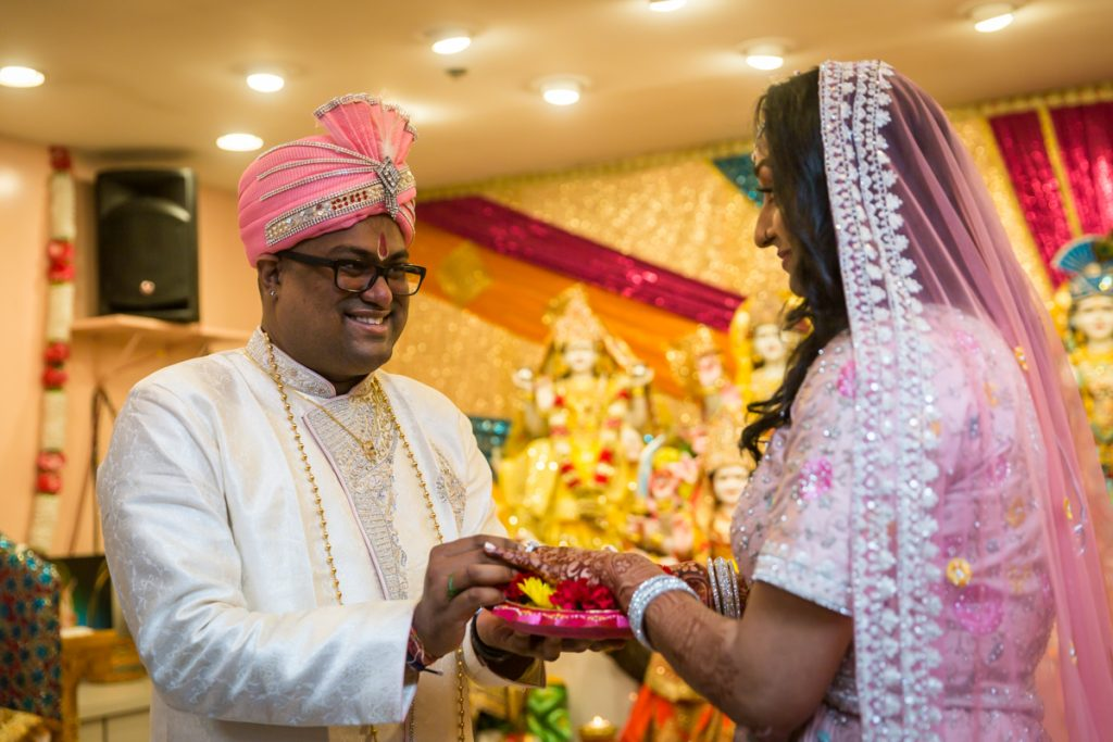 Sagai ceremony photos of groom giving bride a ring