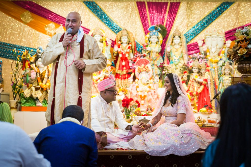 Bride and groom looking at each other during Hindu engagement ceremony speeches