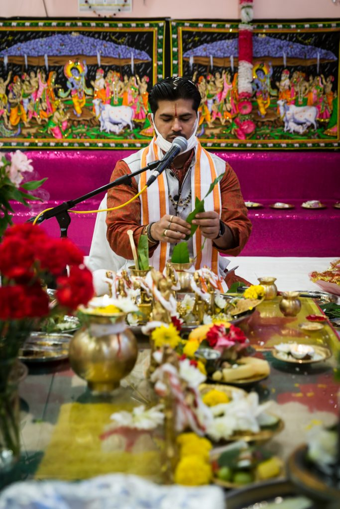 Priest performing rituals during Hindu engagement ceremony