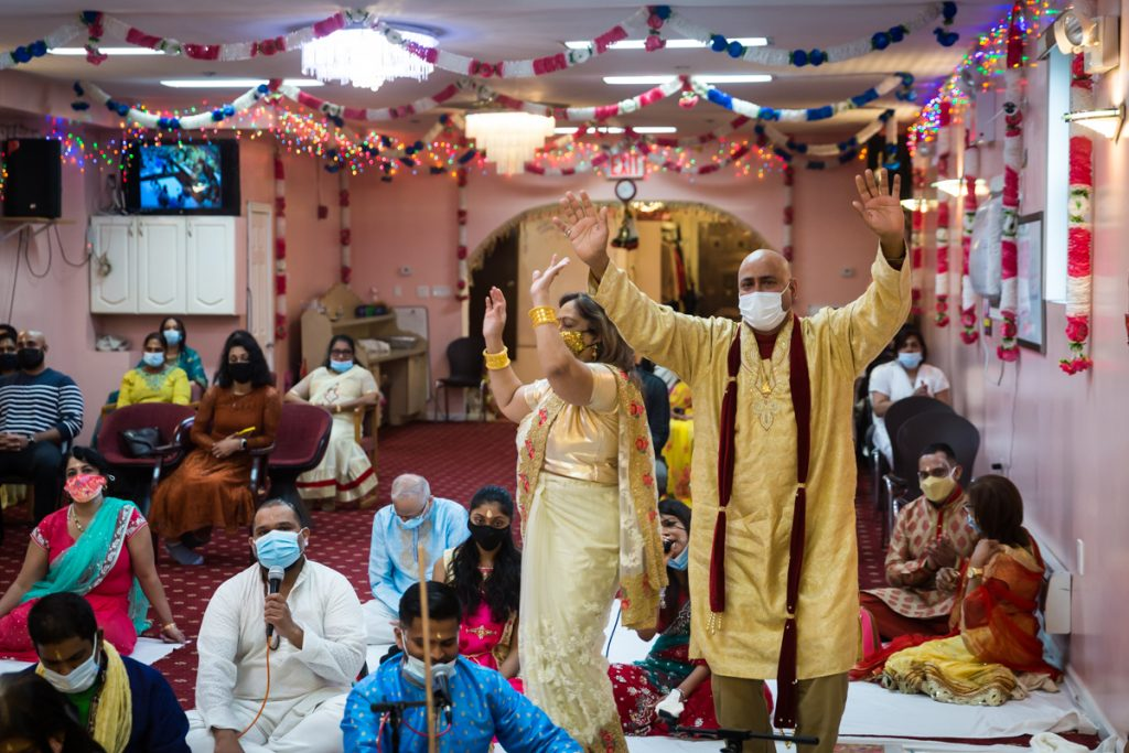 Guests dancing during Hindu engagement ceremony