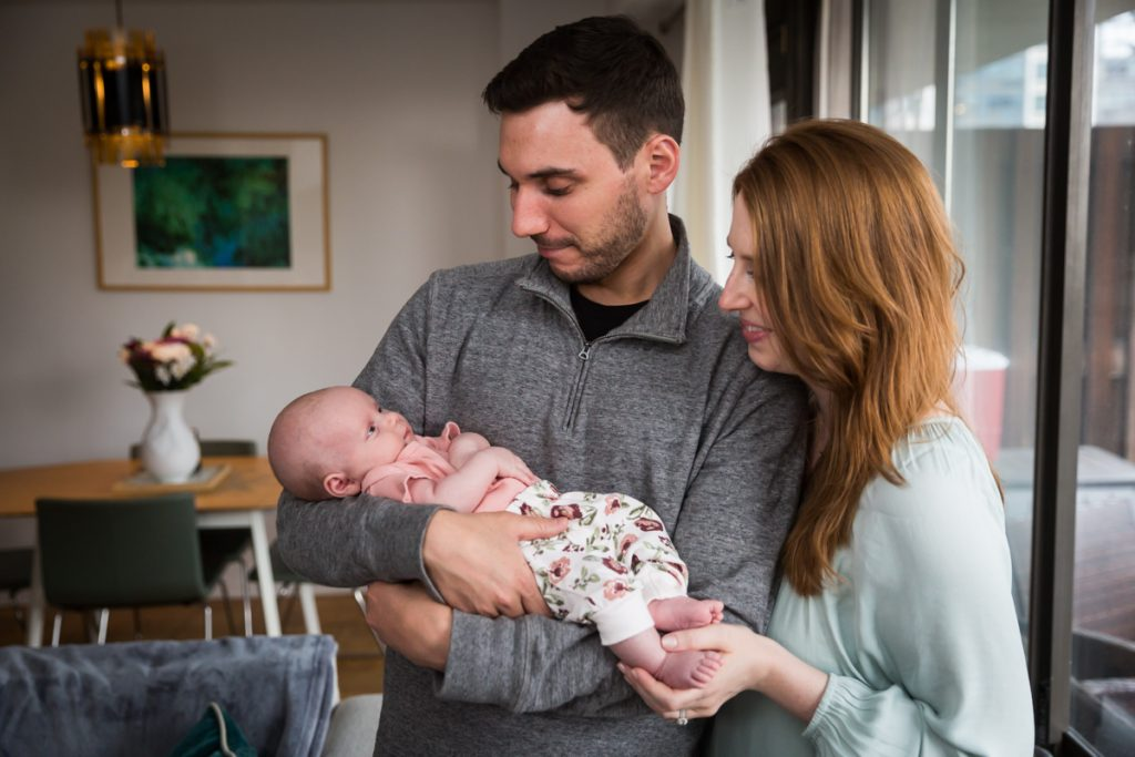 Upper West Side newborn portrait of parents holding baby