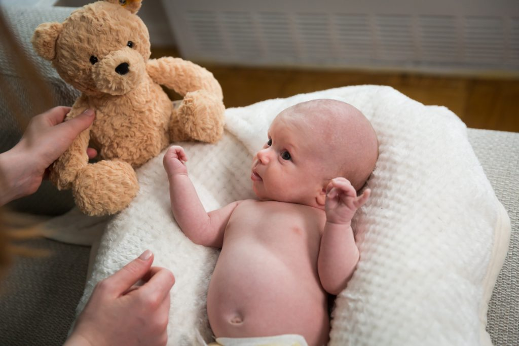 Upper West Side newborn portrait of baby with teddy bear