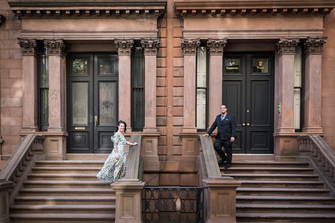 Couple standing on brownstone staircases
