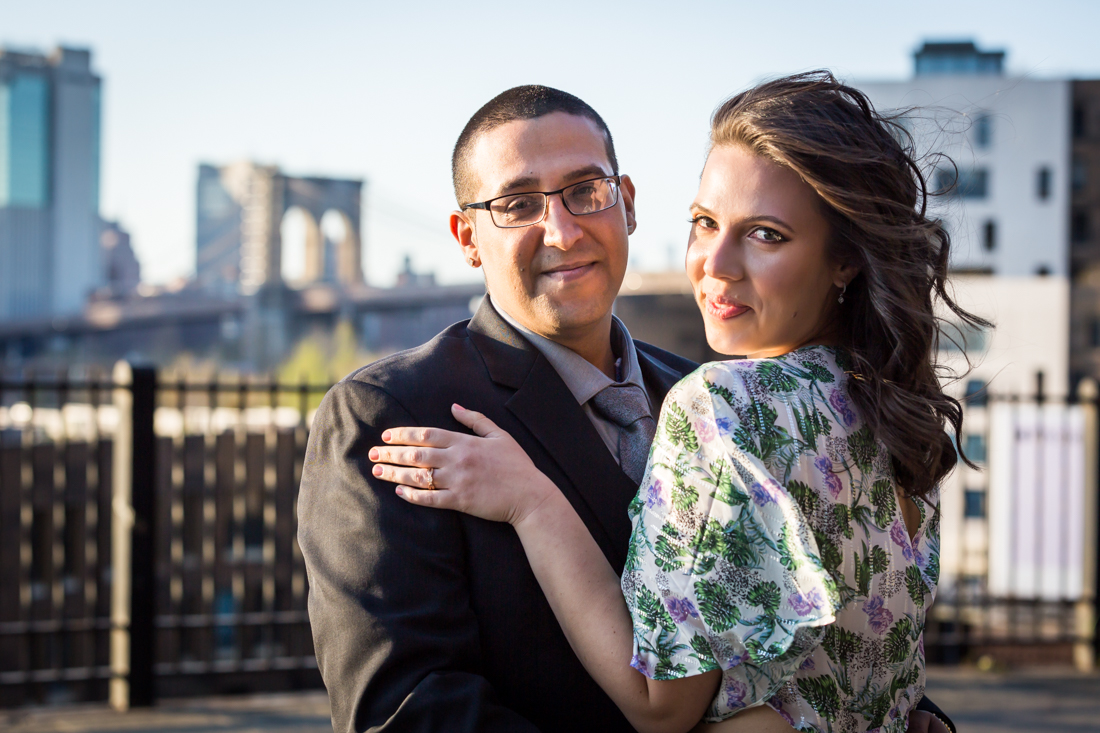 Couple hugging during a Brooklyn Heights Promenade engagement photo shoot