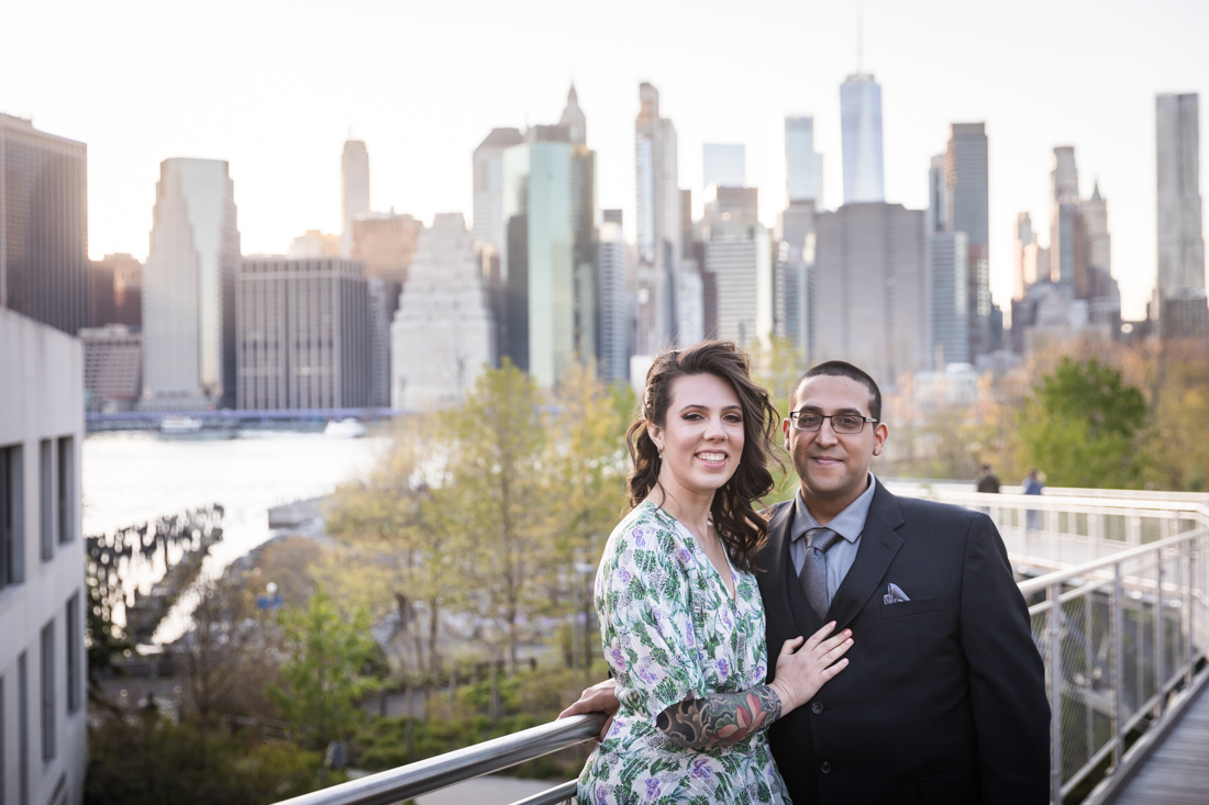 Couple on walkway in front of Manhattan skyline