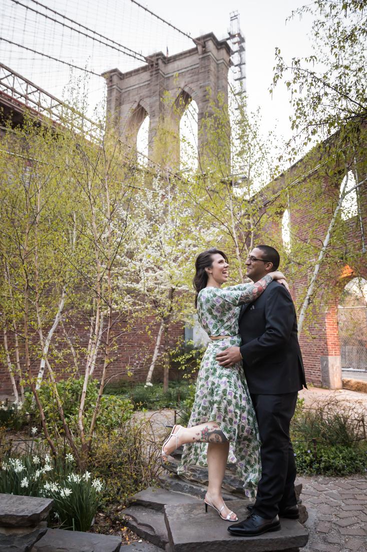 Couple in front of Brooklyn Bridge in Max Family Garden