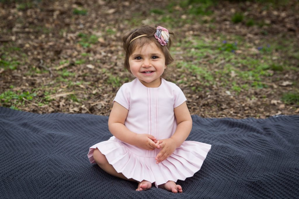 Little girl wearing a pink dress for an article on NYC family portrait location ideas