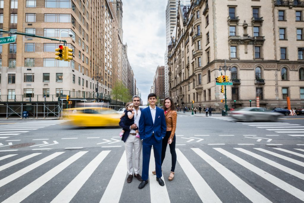 Family standing in a NYC crosswalk for an article on NYC family portrait location ideas