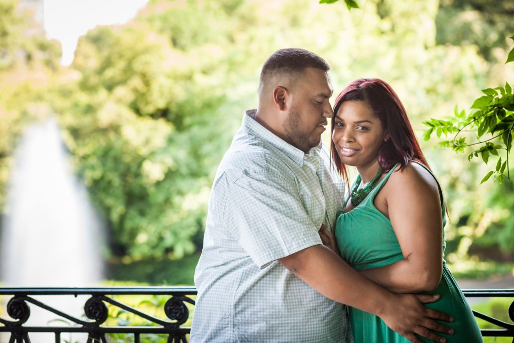 Couple hugging in Conservatory Garden during a Central Park engagement shoot