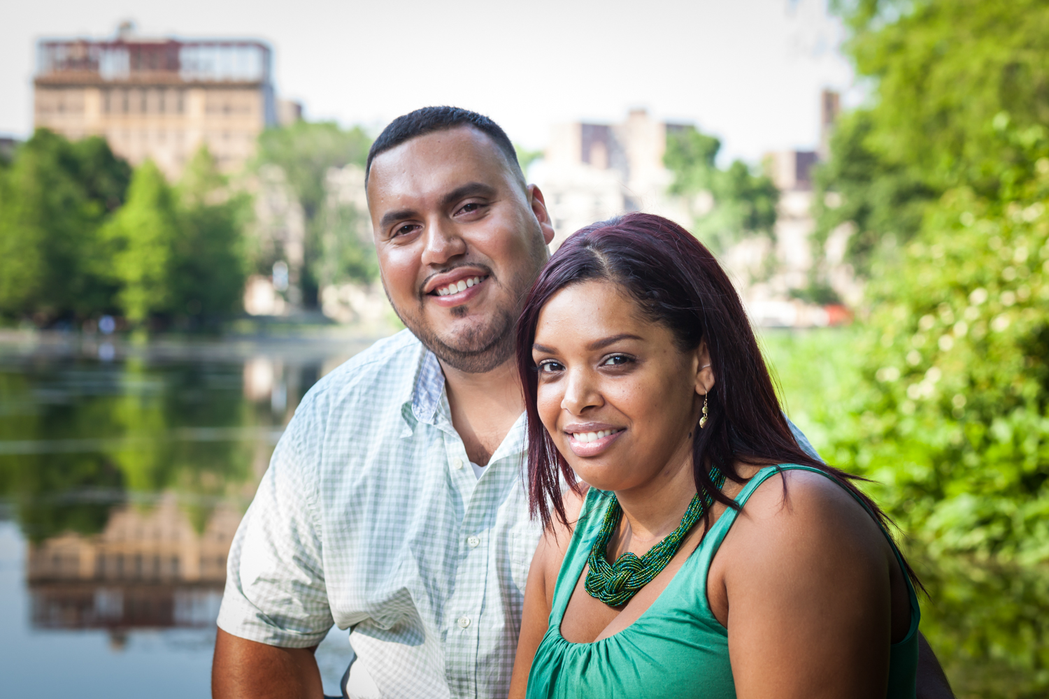 Portrait of couple in front of lake during a Central Park engagement shoot