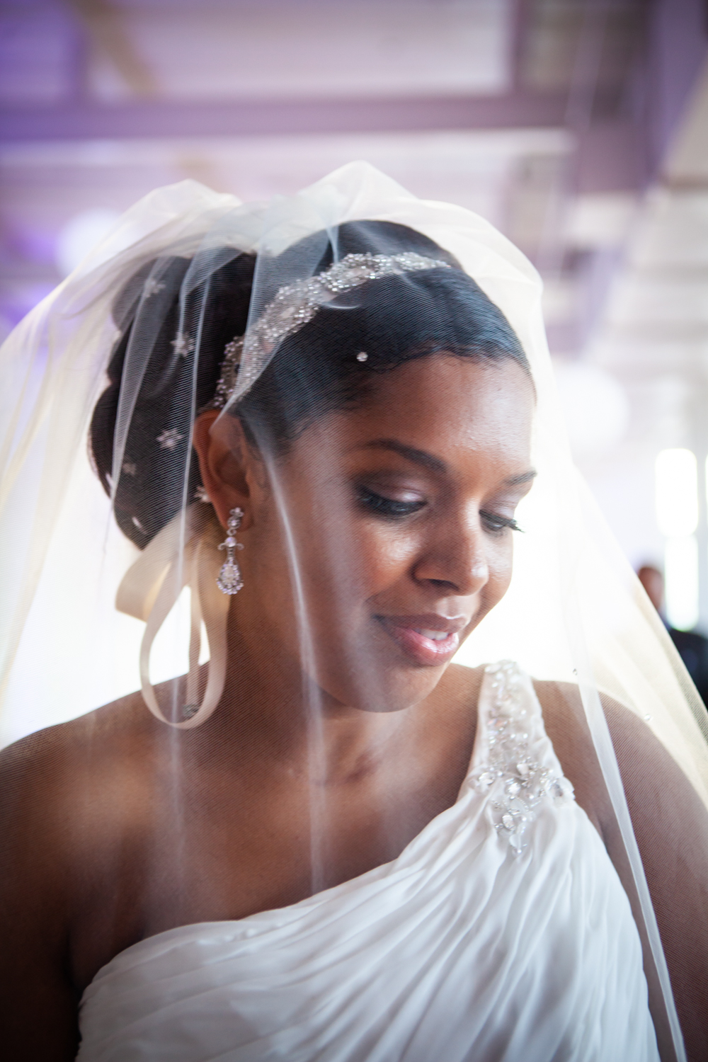 Portrait of bride wearing veil at an Attic Studios wedding