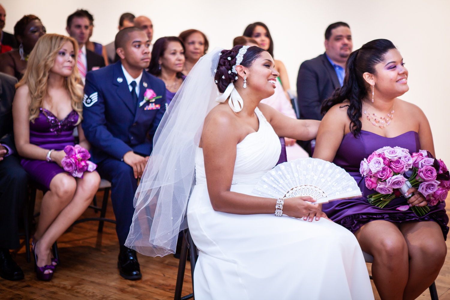 Bride and guests listening to ceremony at an Attic Studios wedding
