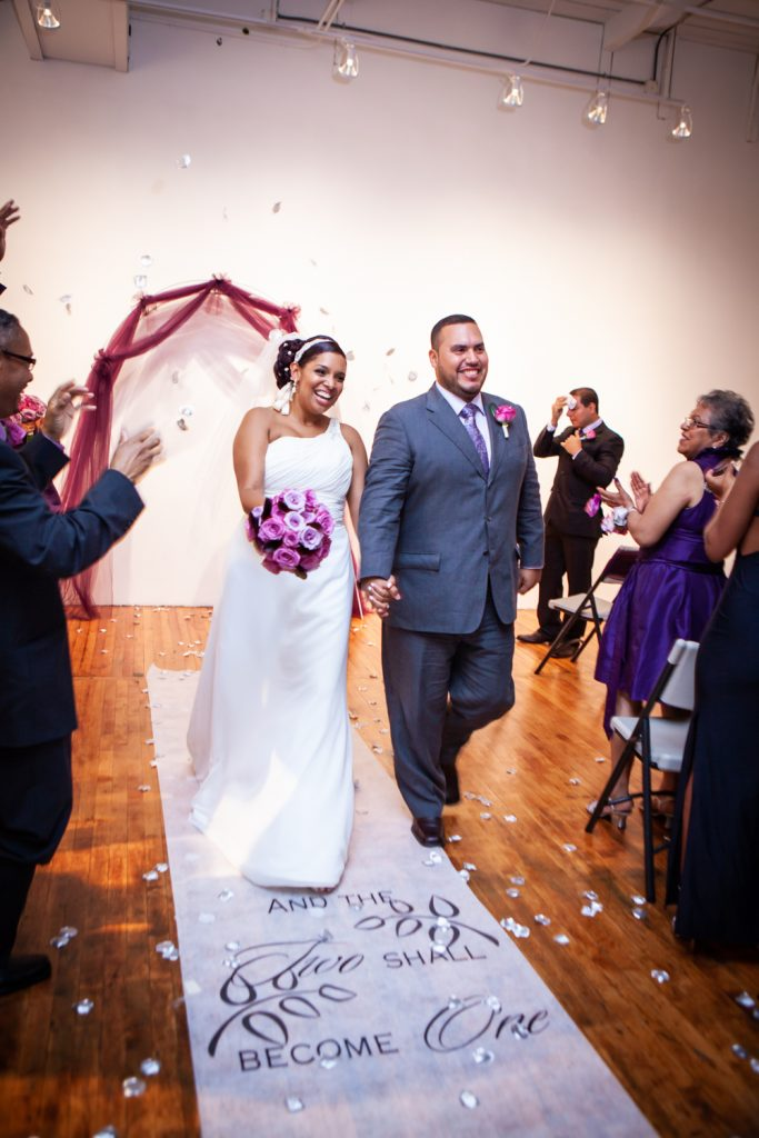 Bride and groom walking down aisle after Attic Studios ceremony