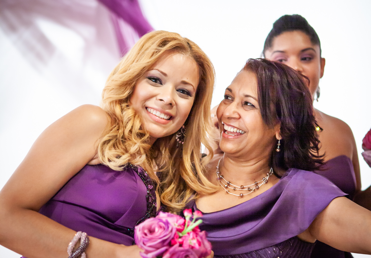 Bridesmaid and mother wearing purple dresses at an Attic Studios wedding
