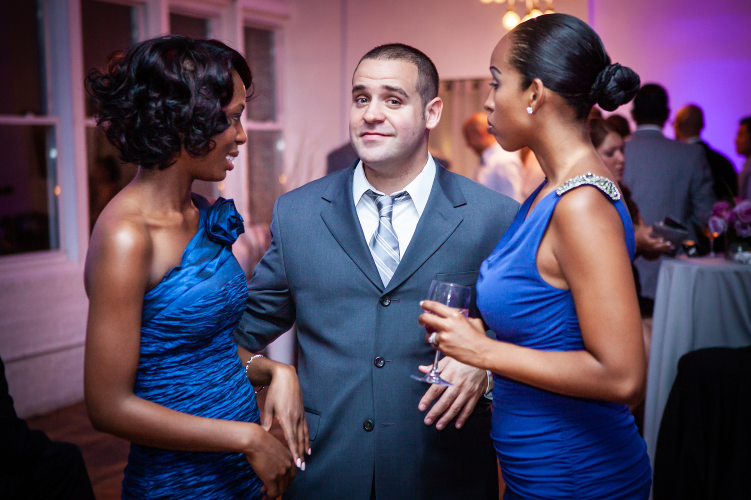 Male guest flanked by two female guests at an Attic Studios wedding