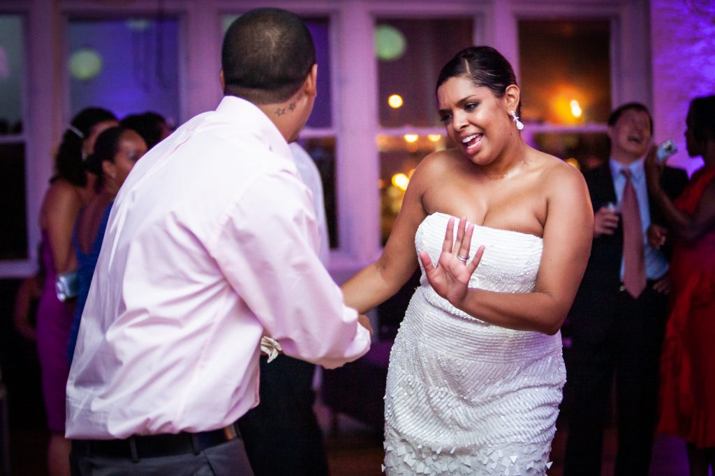 Bride dancing with guest at an Attic Studios wedding