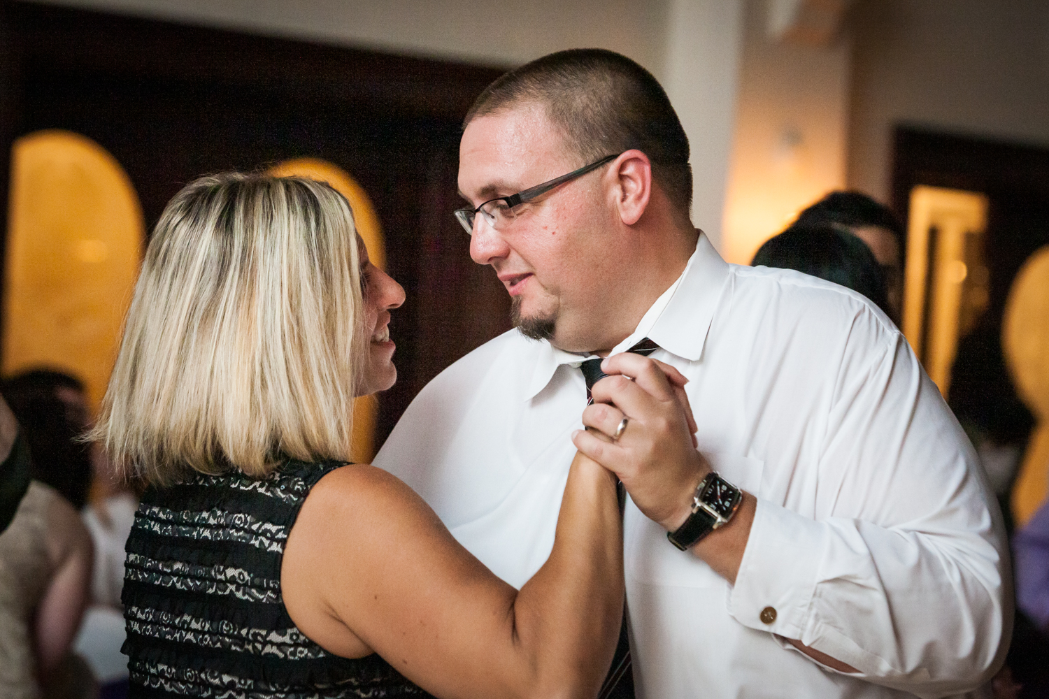 Couple dancing close at a Fort Hamilton Community Center wedding