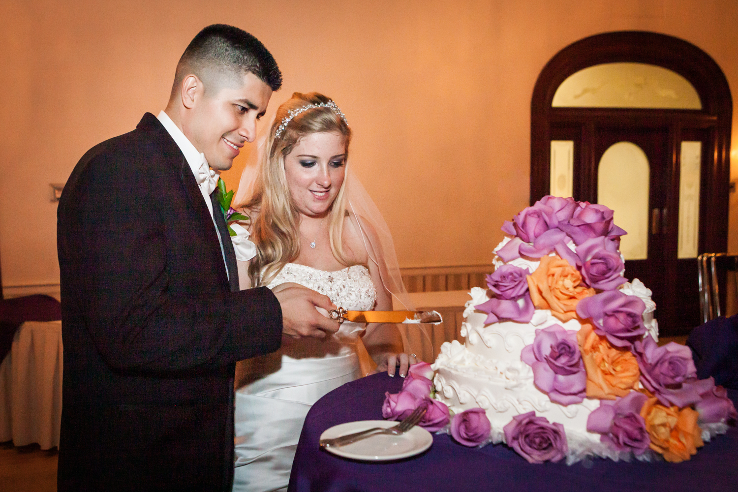 Bride and groom cutting cake at a Fort Hamilton Community Center wedding