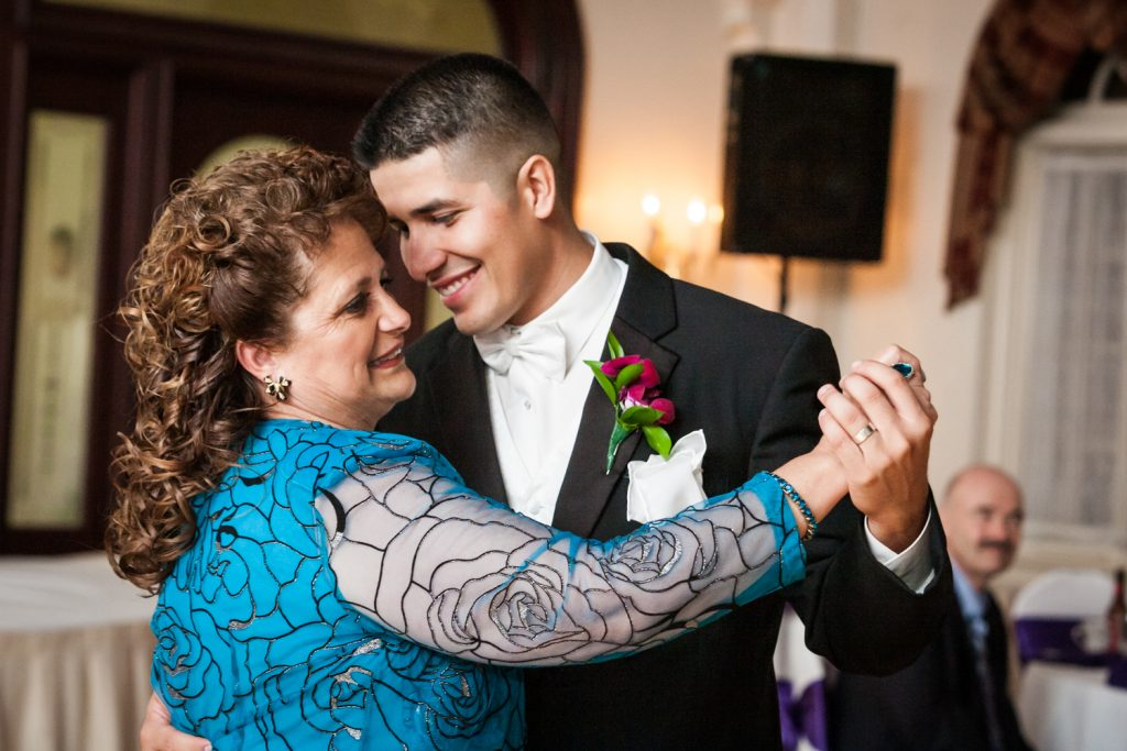 Groom dancing with mother at a Fort Hamilton Community Center wedding