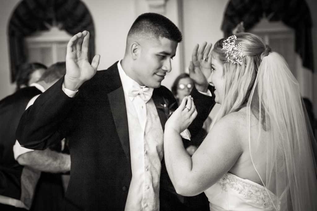Black and white photo of bride and groom dancing at a Fort Hamilton Community Center wedding