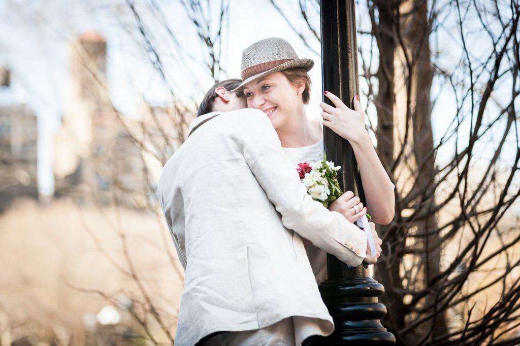 Washington Square Park portrait of man hugging woman around lamp post