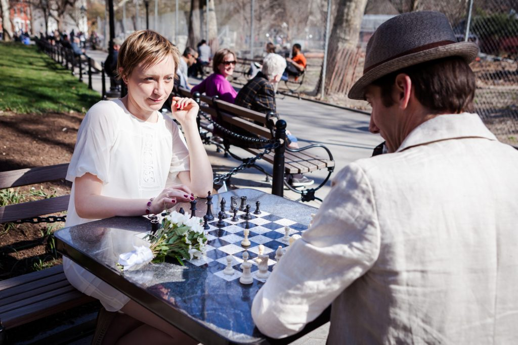 Couple playing chess in Washington Square Park