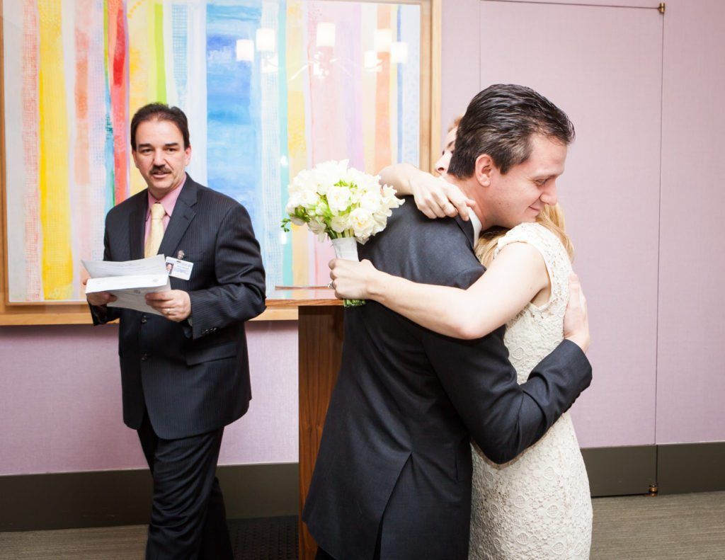 Ceremony at a Manhattan Marriage Bureau wedding, by NYC wedding photojournalist, Kelly Williams