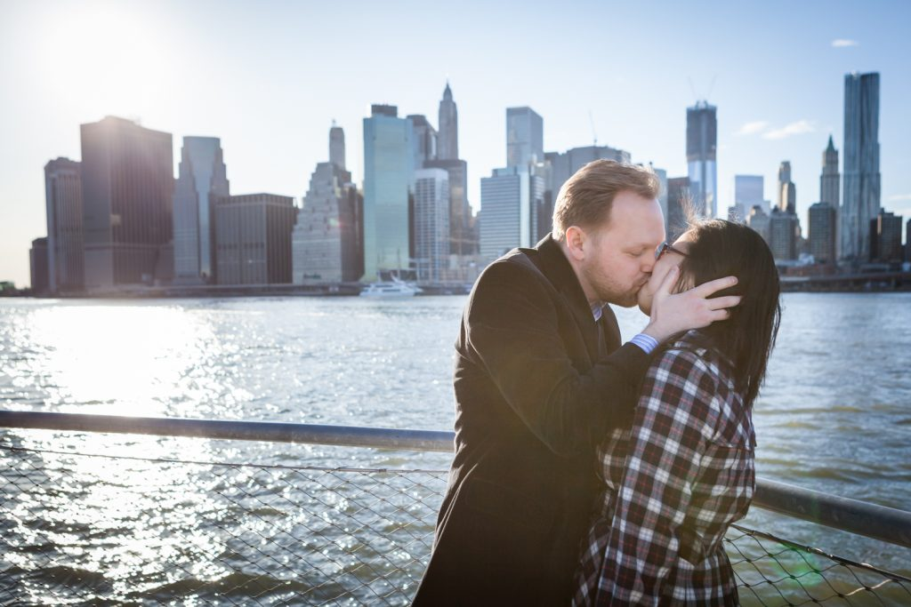Couple kissing in front of East River