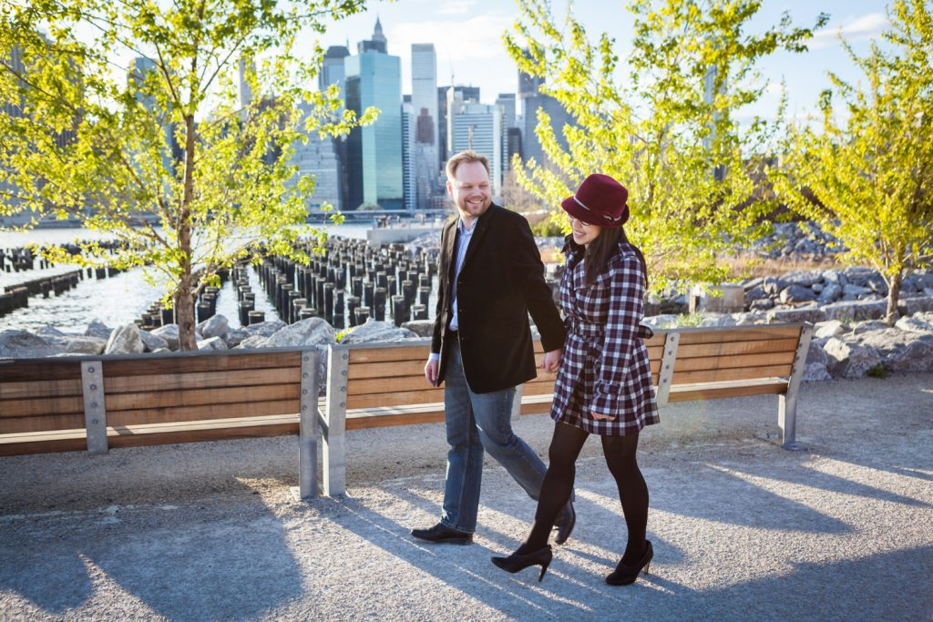 Couple walking along pathway in Brooklyn Bridge Park